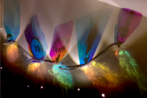 Menorah (1)-Cosmic Re-genesis, Enacting Tikkun Olam, 2020, Radiant Film/Silhouettes/Acrylic Discs/Metal Strapping, 6ftHx14ftWx12inD